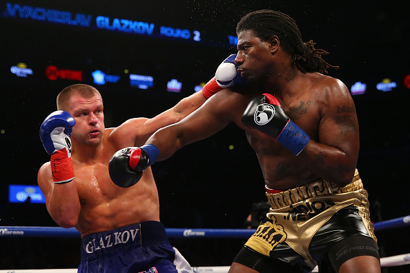 NEW YORK, NY - JANUARY 16: Vyacheslav Glazkov punches Charles Martin during their IBF World Heavyweight Championship bout at Barclays Center on January 16, 2016 in Brooklyn borough of New York City. (Photo by Mike Stobe/Getty Images)