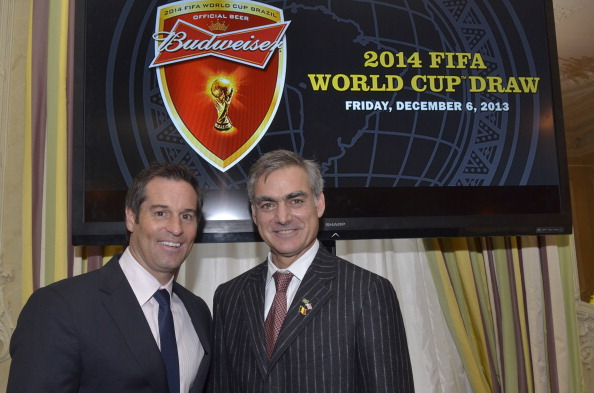 WASHINGTON, DC - DECEMBER 6:  John Harkes, (Former captain, US men's national team)  and Dr. Scott Ratzan, (Vice President, Global Corporate Affairs, Anheuser-Busch InBev) gathered at the Brazilian Ambassador's residence in Washington DC on December 6, 2013 to celebrate the 2014 FIFA World Cup Brazil Final Draw.  In partnership with Budweiser, the global official beer of the FIFA World Cup, Garibaldi created a commemorative work of art representing the 32 countries competing in the tournament next summer and their quest to be crowned the best in the world.   (Photo by Kris Connor/Getty Images for Budweiser)