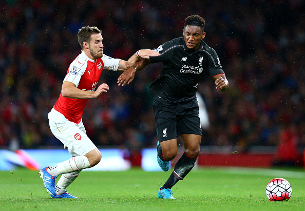 LONDON, ENGLAND - AUGUST 24: Joe Gomez of Liverpool takes on Aaron Ramsey of Arsenal during the Barclays Premier League match between Arsenal and Liverpool at the Emirates Stadium on August 24, 2015 in London, United Kingdom. (Photo by Clive Mason/Getty Images)