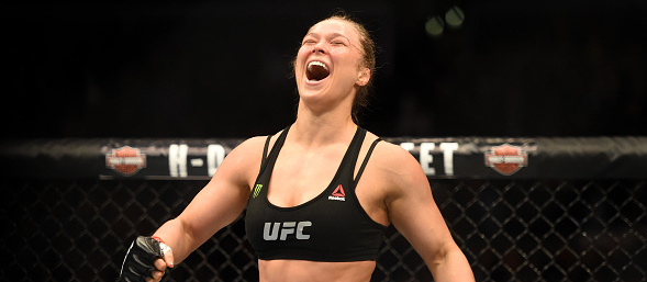 <> in their UFC women's bantamweight championship bout during the UFC 184 event at Staples Center on February 28, 2015 in Los Angeles, California.