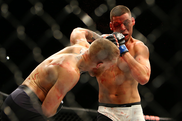 LAS VEGAS, NV - MARCH 5: Conor McGregor punches Nate Diaz during UFC 196 at the MGM Grand Garden Arena on March 5, 2016 in Las Vegas, Nevada. (Photo by Rey Del Rio/Getty Images)