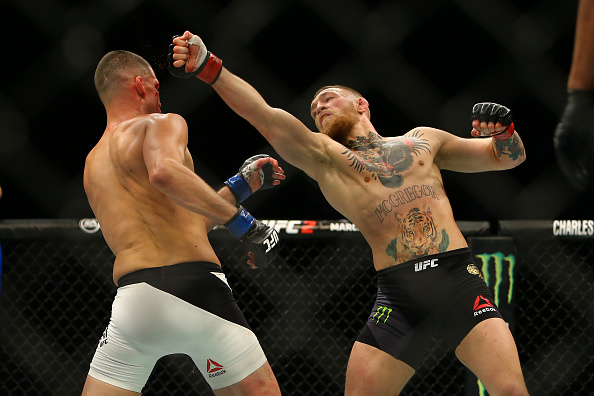 LAS VEGAS, NV - MARCH 5: Conor McGregor (R) punches Nate Diaz during UFC 196 at the MGM Grand Garden Arena on March 5, 2016 in Las Vegas, Nevada. (Photo by Rey Del Rio/Getty Images)