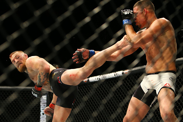 LAS VEGAS, NV - MARCH 5: Conor McGregor (L) kicks Nate Diaz during UFC 196 at the MGM Grand Garden Arena on March 5, 2016 in Las Vegas, Nevada. (Photo by Rey Del Rio/Getty Images)
