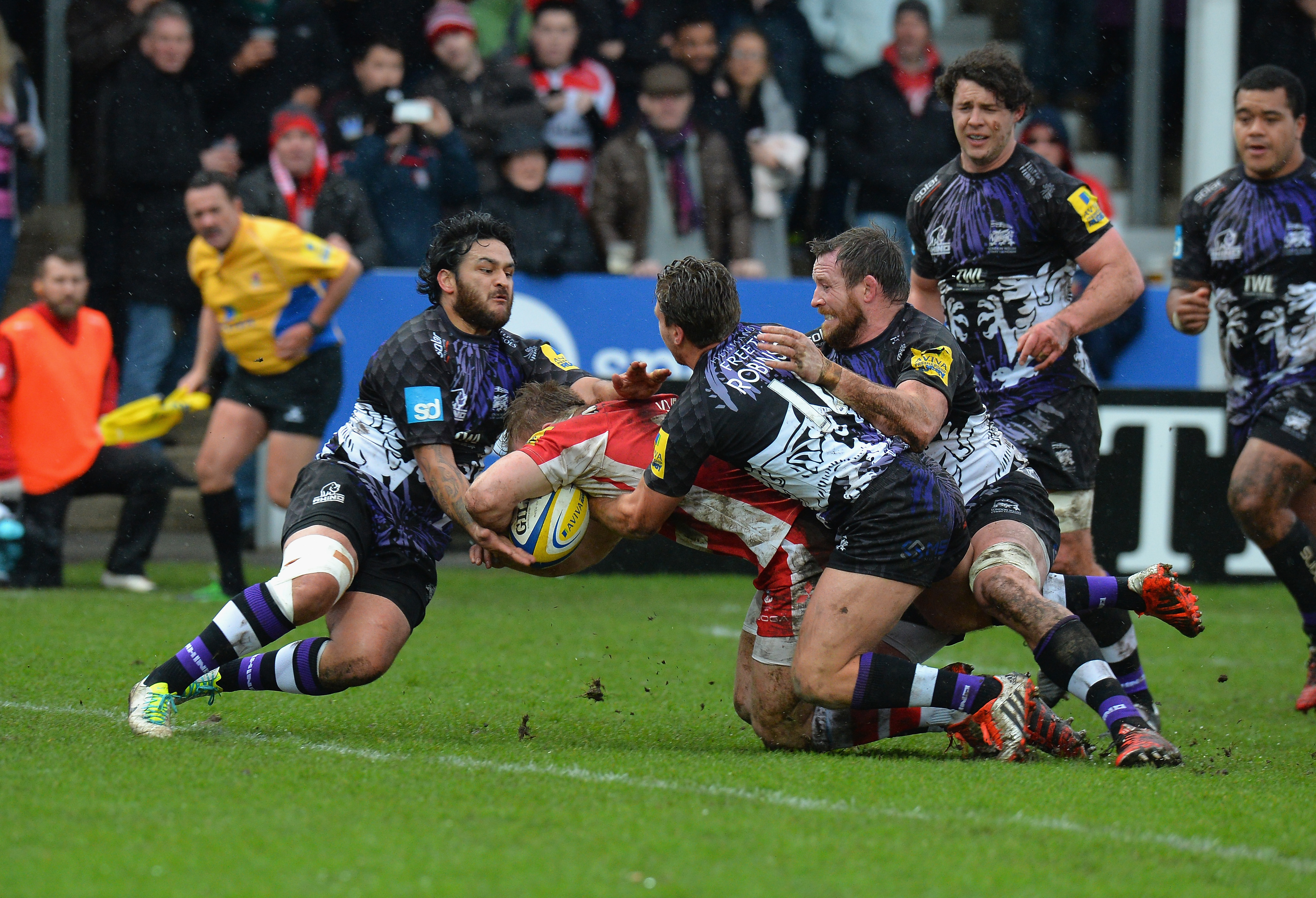 xxxx of Gloucester Rugby is tackled by xxxx of London Welsh during the Aviva Premiership match between Gloucester Rugby and London Welsh at Kingsholm Stadium on February 21, 2015 in Gloucester, England.