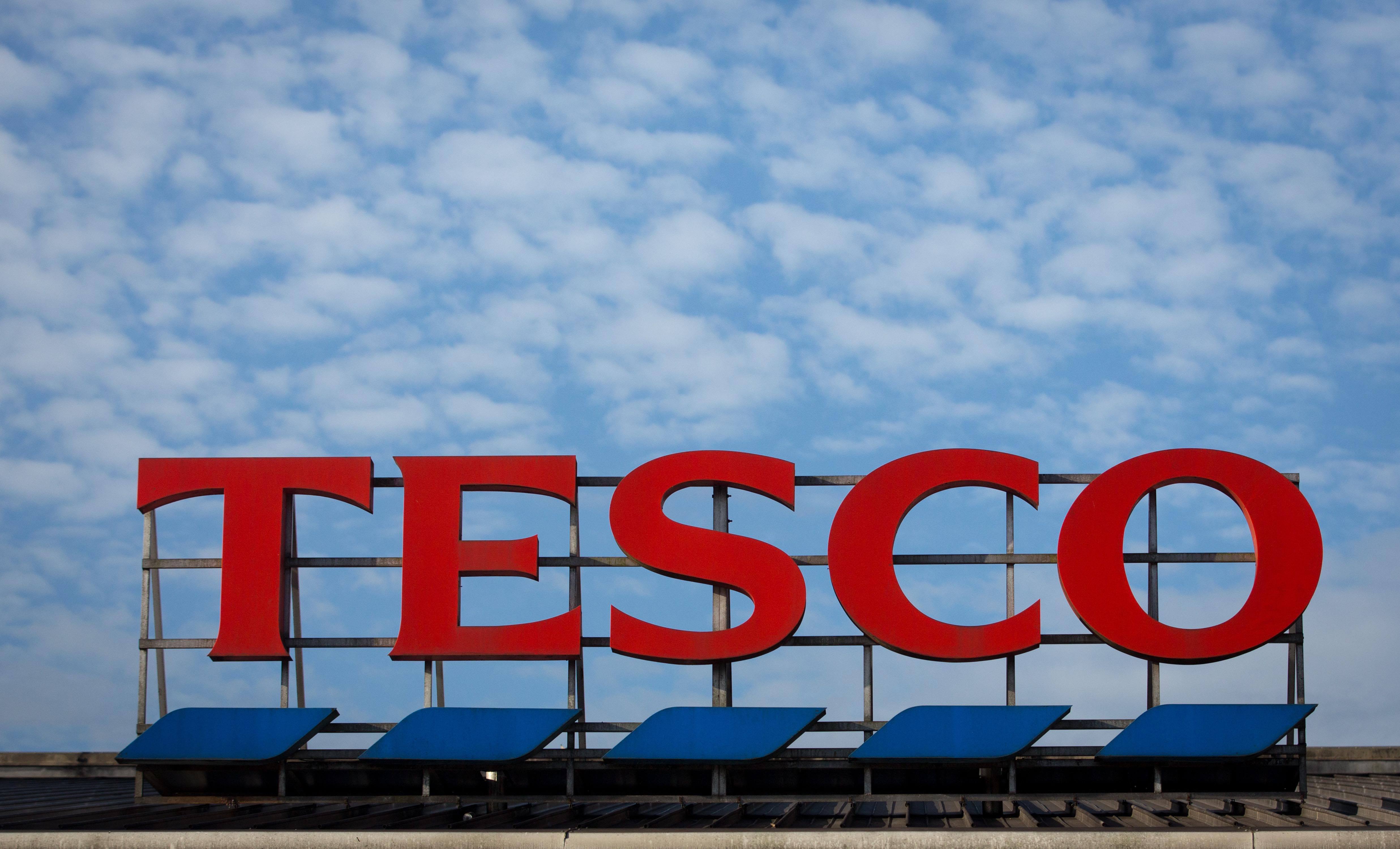 BRISTOL, ENGLAND - NOVEMBER 18: The Tesco sign is displayed outside a branch of the supermarket on November 18, 2015 in Bristol, England. As the crucial Christmas retail period approaches, all the major supermarkets are becoming increasingly competitive to retain and increase their share of the market. (Photo by Matt Cardy/Getty Images)
