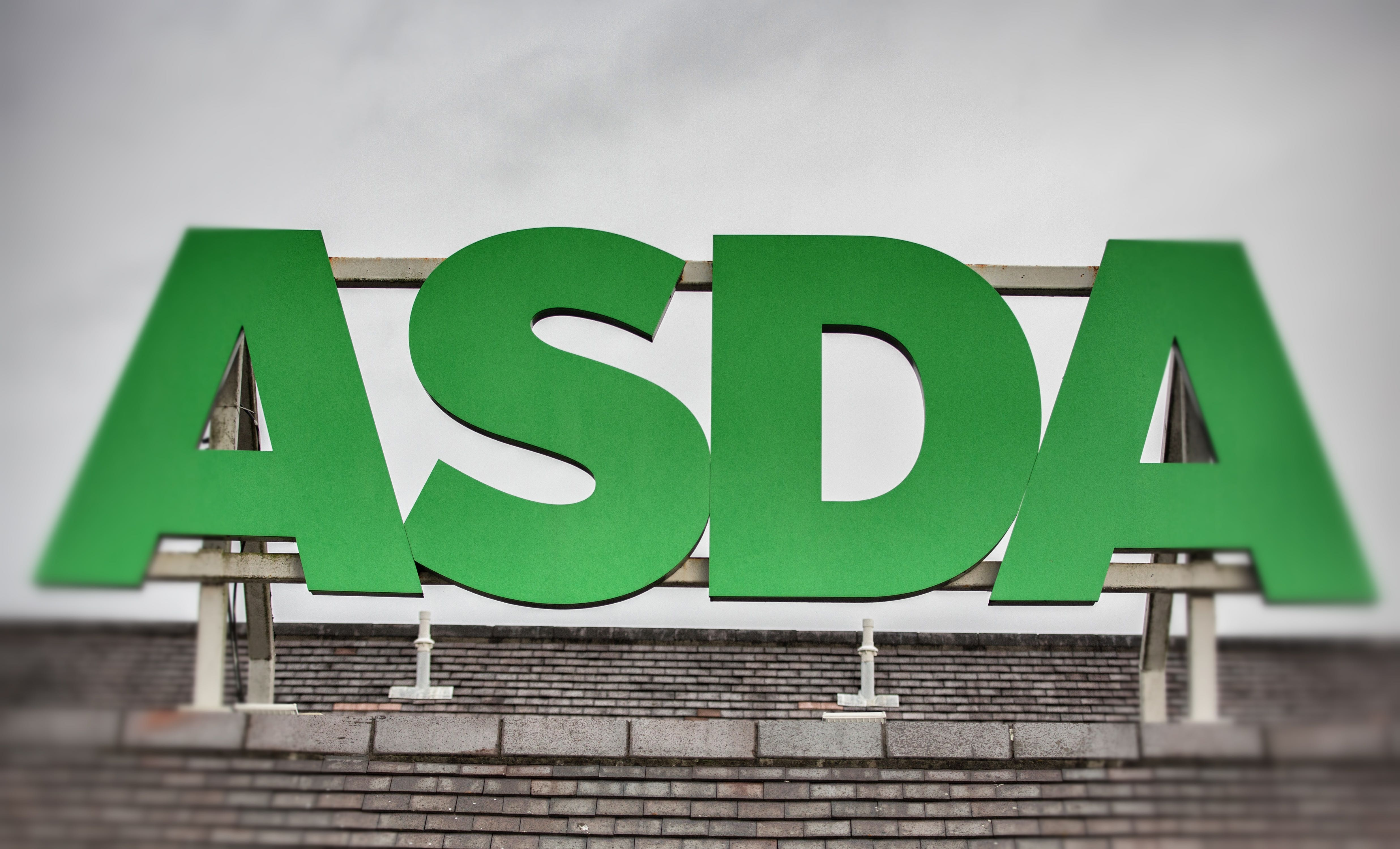 BRISTOL, ENGLAND - NOVEMBER 18: (EDITORS NOTE: This image was created using digital filters) The Asda sign is displayed outside a branch of the supermarket on November 18, 2015 in Bristol, England. As the crucial Christmas retail period approaches, all the major supermarkets are becoming increasingly competitive to retain and increase their share of the market. (Photo by Matt Cardy/Getty Images)