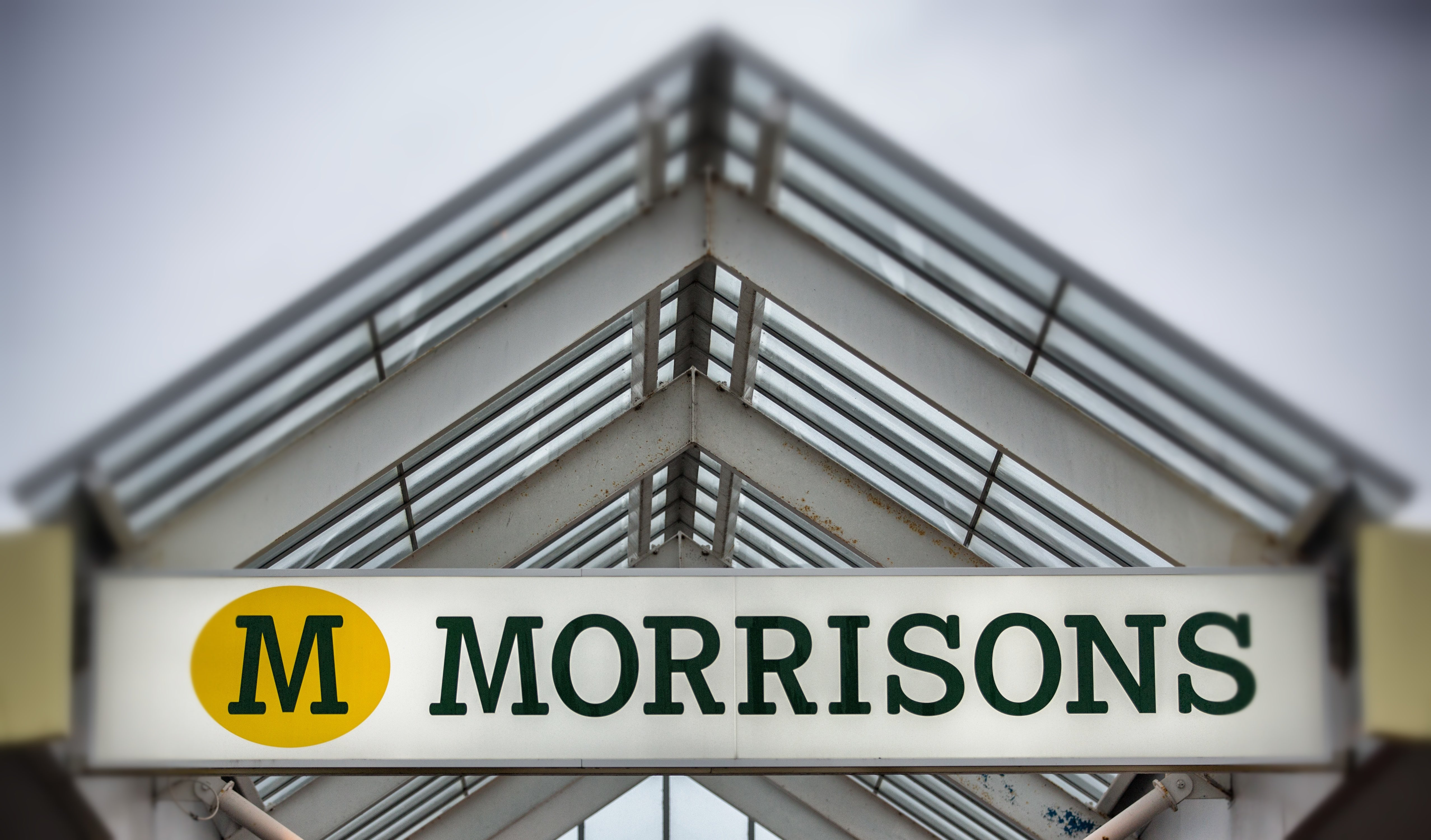 BRISTOL, ENGLAND - NOVEMBER 18: (EDITORS NOTE: This image was created using digital filters) The Morrisons sign is displayed outside a branch of the supermarket on November 18, 2015 in Bristol, England. As the crucial Christmas retail period approaches, all the major supermarkets are becoming increasingly competitive to retain and increase their share of the market. (Photo by Matt Cardy/Getty Images)