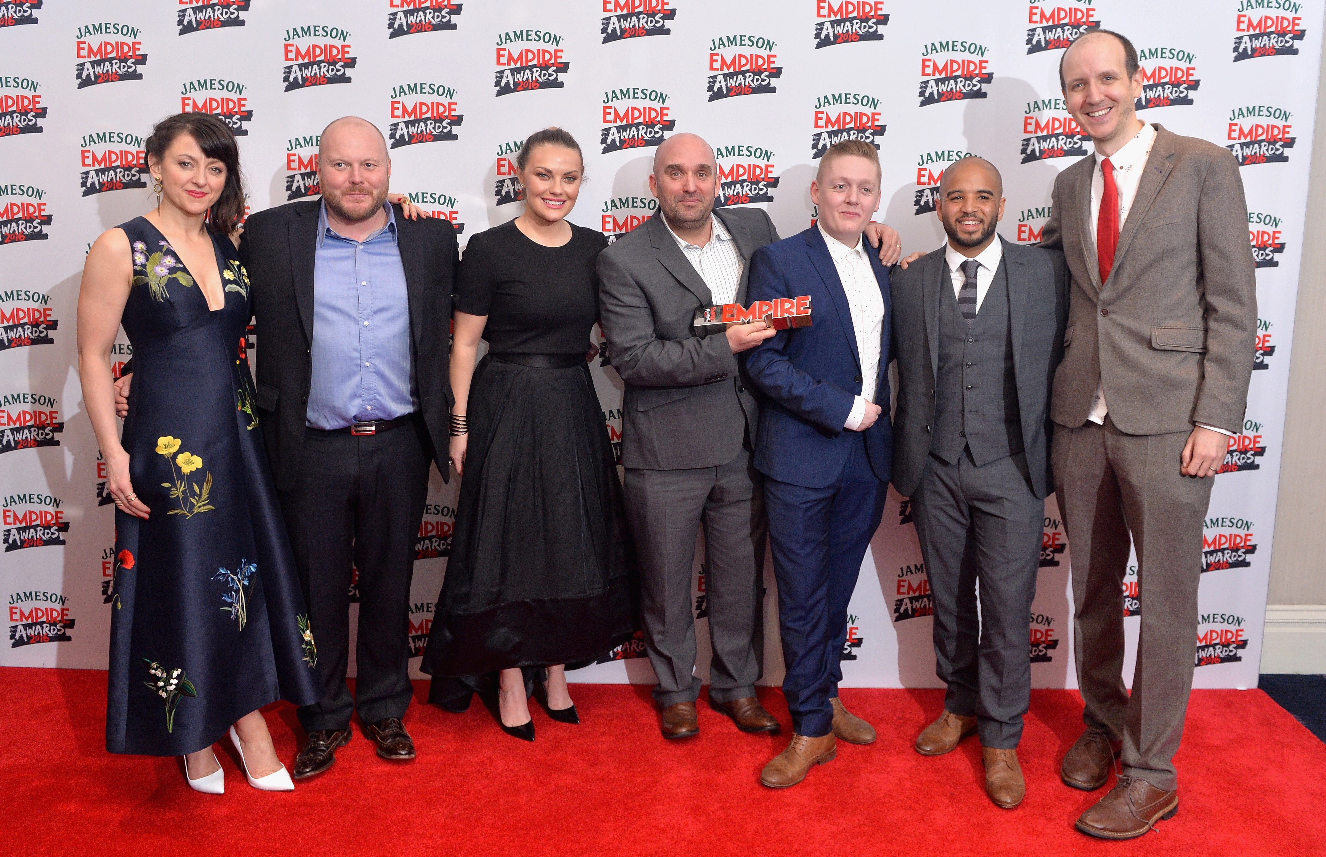 LONDON, ENGLAND - MARCH 20: Cast of This Is England '90; Jo Hartley, Mark Herbert, Chanel Cresswell, Shane Meadows, Thomas Turgoose, Andrew Shim and guest pose in the winners room at the Jameson Empire Awards 2016 at The Grosvenor House Hotel on March 20, 2016 in London, England. (Photo by Anthony Harvey/Getty Images)