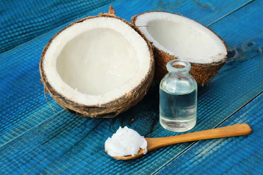 Coconut and coconut oil on blue rustic wooden background