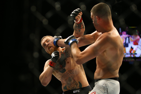 LAS VEGAS, NV - MARCH 5: Nate Diaz punches Conor McGregor during UFC 196 at the MGM Grand Garden Arena on March 5, 2016 in Las Vegas, Nevada. (Photo by Rey Del Rio/Getty Images)