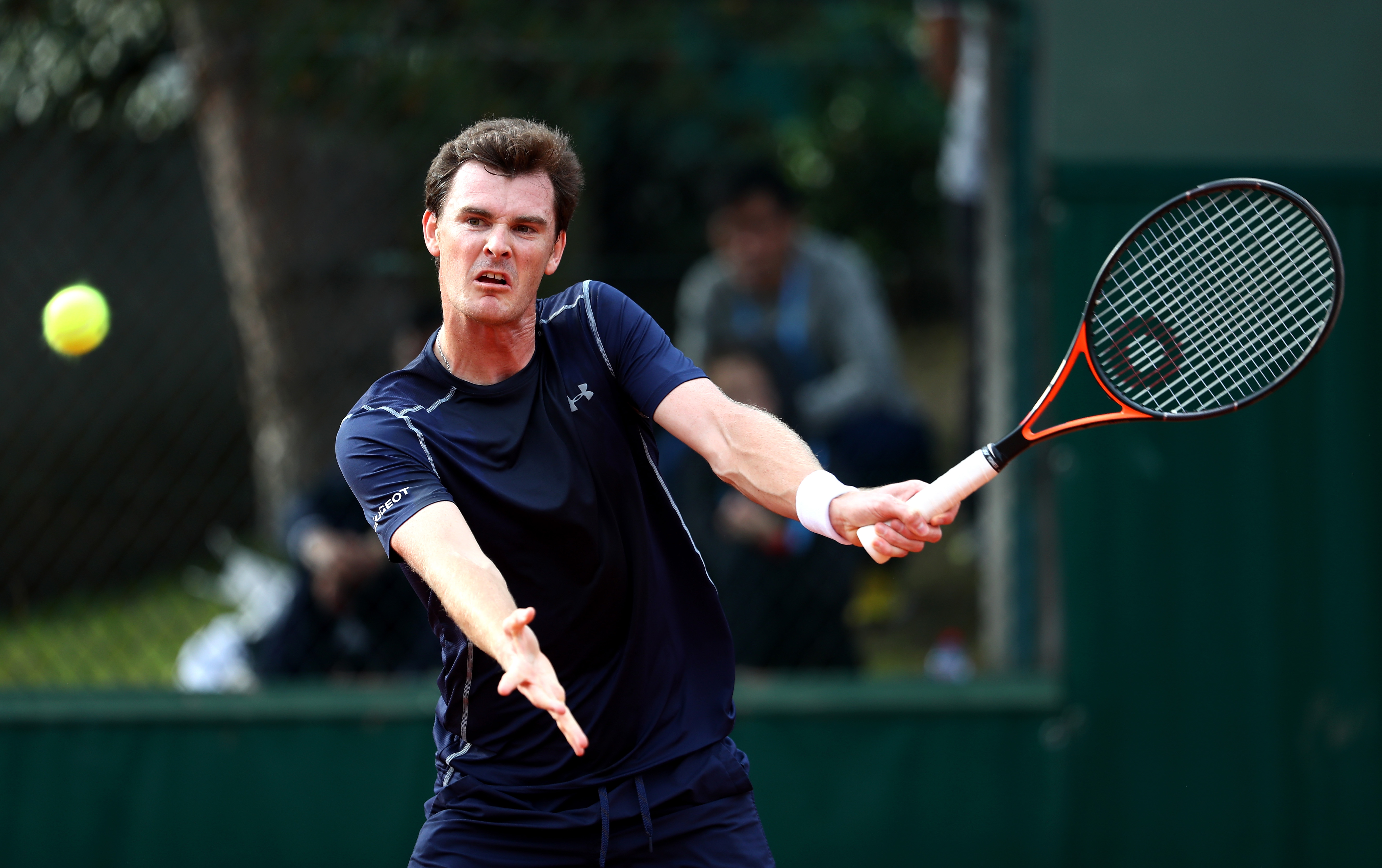 PARIS, FRANCE - MAY 26: Jamie Murray of Great Britain hits a forehand during the Mixed Doubles first round match against Daria Gavrilova and John Peers of Australia on day five of the 2016 French Open at Roland Garros on May 26, 2016 in Paris, France. (Photo by Julian Finney/Getty Images)