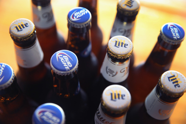 CHICAGO, IL - SEPTEMBER 15: In this photo illustration, bottles of Miller Lite and Bud Light beer that are products of SABMiller and Anheuser-Busch InBev (respectively) are shown on September 15, 2014 in Chicago. Illinois. Shares of SABMiller have surged to an all-time high today on speculation of a takeover bid by Anheuser-Busch InBev, the world's largest brewer. (Photo Illustration by Scott Olson/Getty Images)