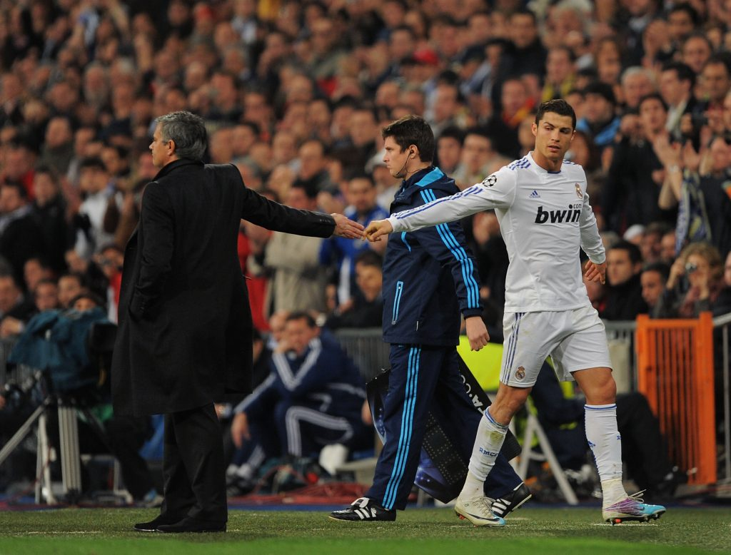 MADRID, SPAIN - MARCH 16: Cristiano Ronaldo (R) of Real Madrid shakes hands with head coach Jose Mourinho after being substituted during the UEFA Champions League round of 16 second leg match between Real Madrid and Lyon at Estadio Santiago Bernabeu on March 16, 2011 in Madrid, Spain. (Photo by Denis Doyle/Getty Images)