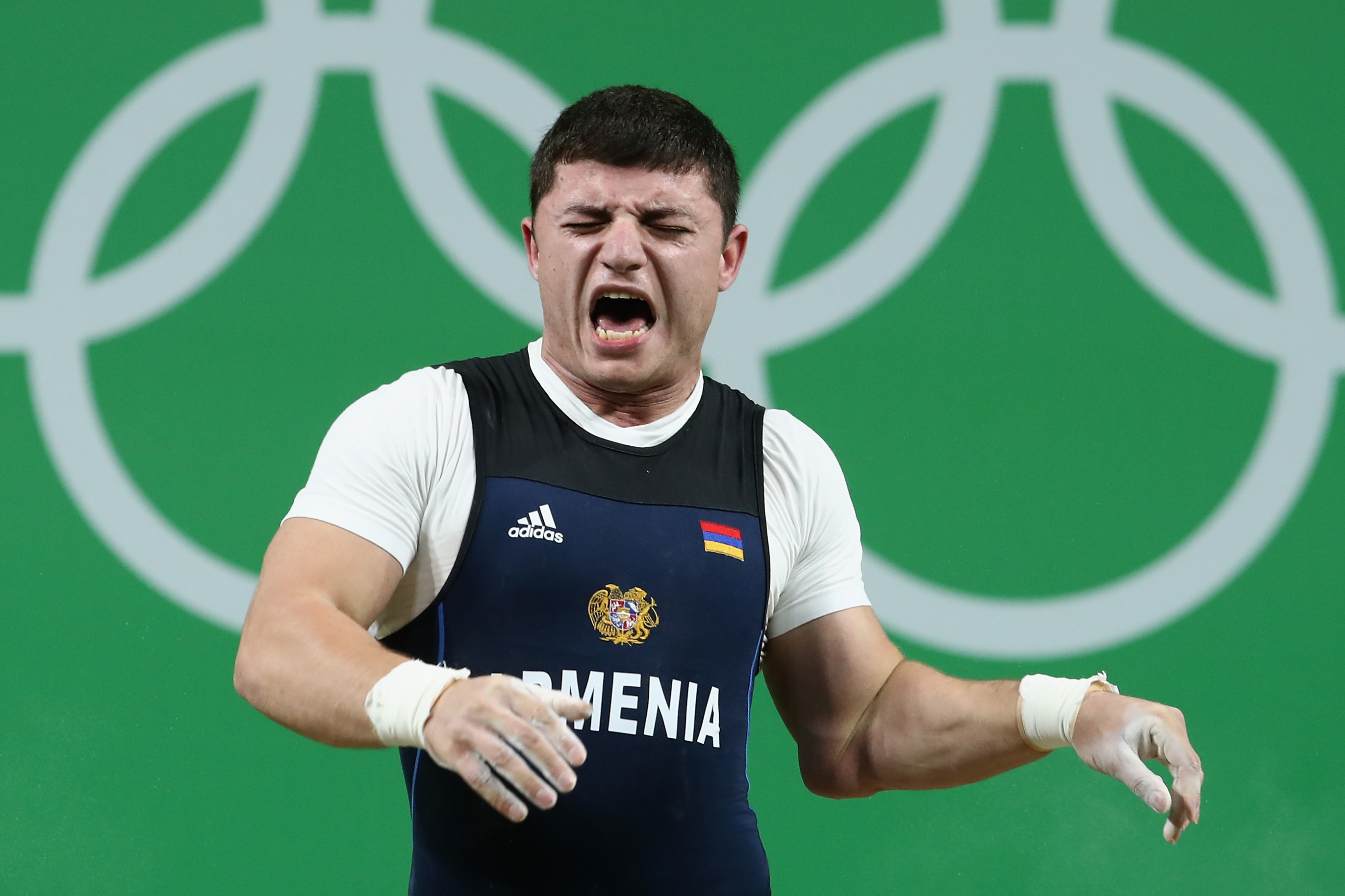 RIO DE JANEIRO, BRAZIL - AUGUST 10: Andranik Karapetyan of Armenia reacts to an injury during the Men's 77kg Group A weightlifting contest on Day 5 of the Rio 2016 Olympic Games at Riocentro - Pavilion 2 on August 10, 2016 in Rio de Janeiro, Brazil. (Photo by Julian Finney/Getty Images)