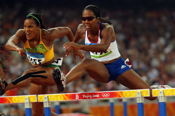 BEIJING - AUGUST 18: (L-R) Bridgitte Foster-Hylton of Jamaica and Sarah Claxton of Great Britain compete in the Women's 100m Hurdles Semi Final at the National Stadium on Day 10 of the Beijing 2008 Olympic Games on August 18, 2008 in Beijing, China. (Photo by Stu Forster/Getty Images)