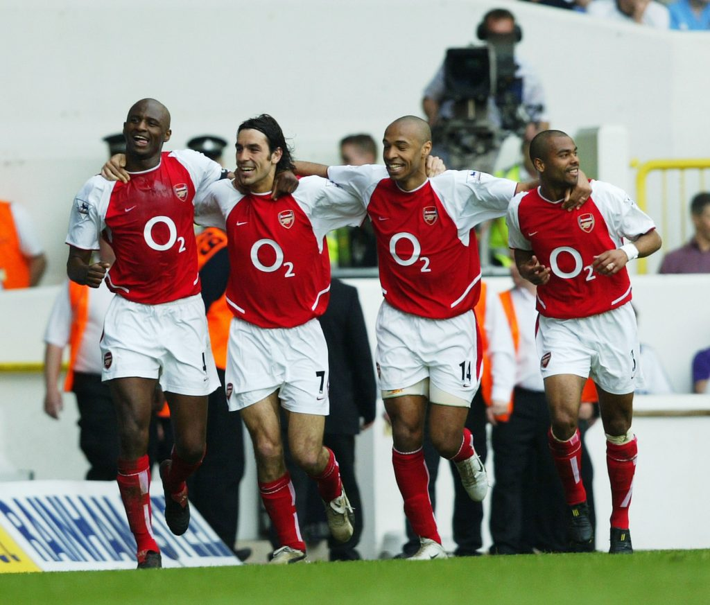 LONDON - APRIL 24: Patrick Viera,Robert Pires,Thierry Henry and Ashley Cole of Arsenal celebrate after the second goal during the FA Barclaycard Premiership match between Tottenham Hotspur and Arsenal at White Hart Lane on April 25, 2004 in London.  (Photo by Shaun Botterill/Getty Images) *** Local Caption *** Patrick Viera;Robert Pires;Thierry Henry;Ashley Cole