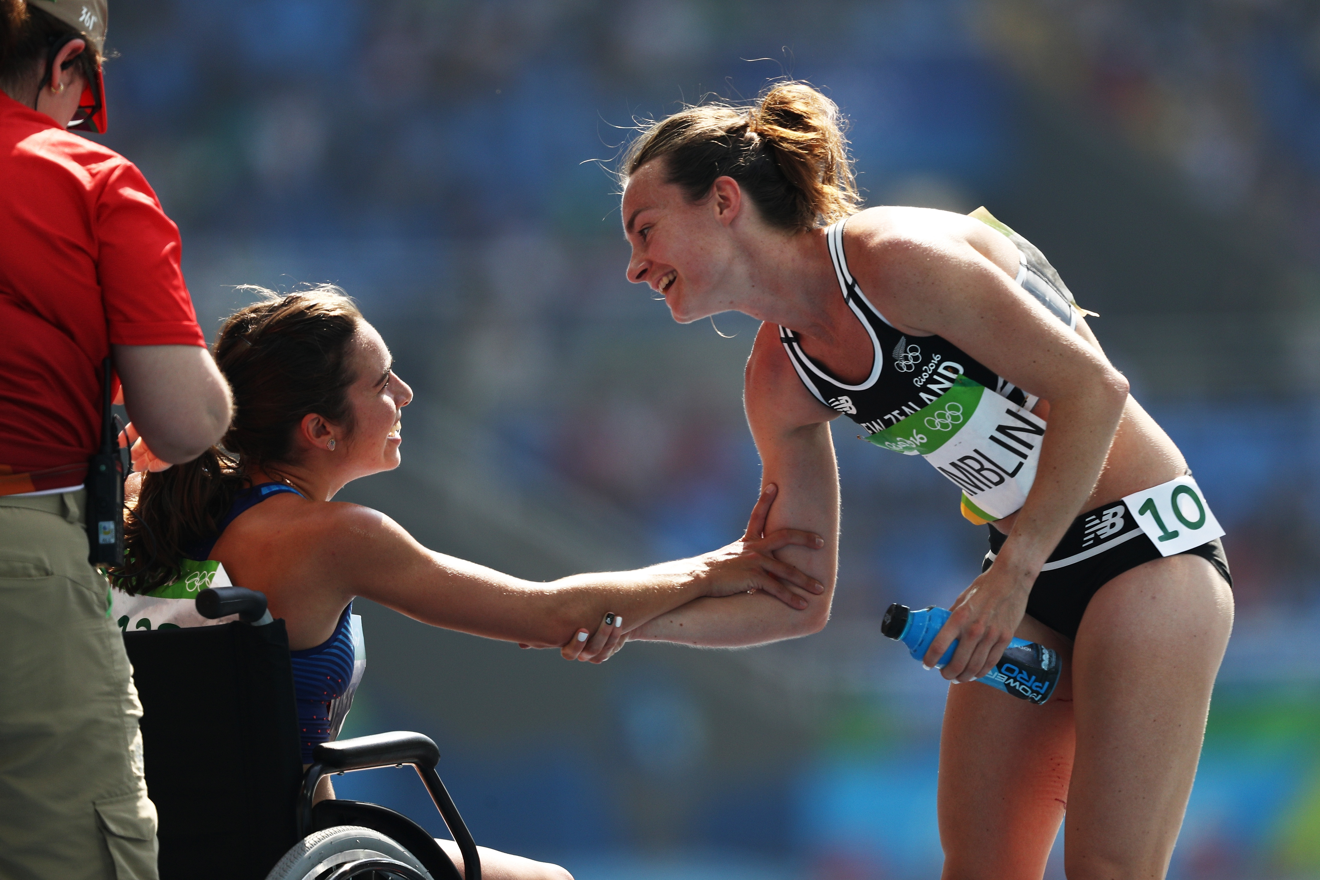 RIO DE JANEIRO, BRAZIL - AUGUST 16: Abbey D'Agostino of the United States (L) talks with Nikki Hamblin of New Zealand after the Women's 5000m Round 1 - Heat 2 on Day 11 of the Rio 2016 Olympic Games at the Olympic Stadium on August 16, 2016 in Rio de Janeiro, Brazil. (Photo by Patrick Smith/Getty Images)