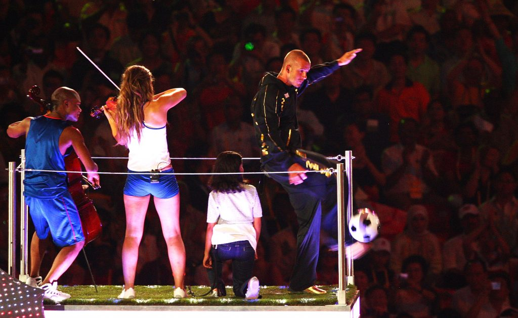 BEIJING - AUGUST 24: Football star David Beckham kicks a football during the Closing Ceremony for the Beijing 2008 Olympic Games at the National Stadium on August 24, 2008 in Beijing, China. (Photo by Mike Hewitt/Getty Images)