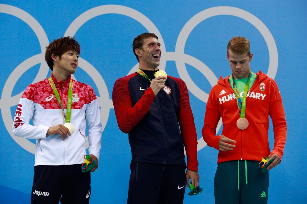 RIO DE JANEIRO, BRAZIL - AUGUST 09: (L-R) Silver medalist Masato Sakai of Japan, gold medalist Michael Phelps of the United States and bronze medalist Tamas Kenderesi of Hungary pose on the podium during the medal ceremony for the Men's 200m Butterfly Final on Day 4 of the Rio 2016 Olympic Games at the Olympic Aquatics Stadium on August 9, 2016 in Rio de Janeiro, Brazil. (Photo by Adam Pretty/Getty Images)