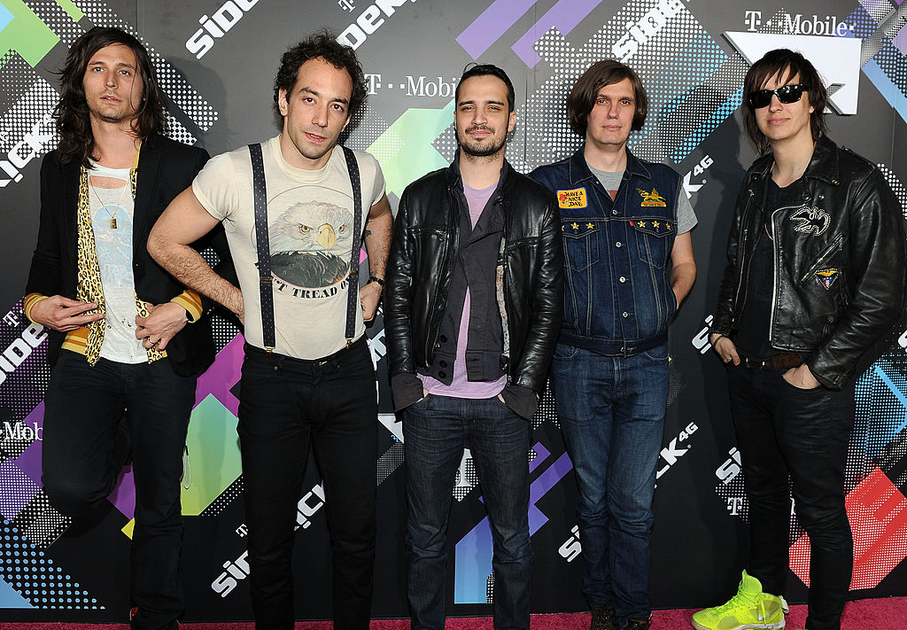 BEVERLY HILLS, CA - APRIL 20: Musicians Nick Valensi, Albert Hammond Jr., Fabrizio Moretti, Nikolai Fraiture and Julian Casablancas of The Strokes arrive at the launch party for the new T-Mobile Sidekick 4G at a Private Lot on April 20, 2011 in Beverly Hills, California. (Photo by Michael Buckner/Getty Images for T-Mobile)