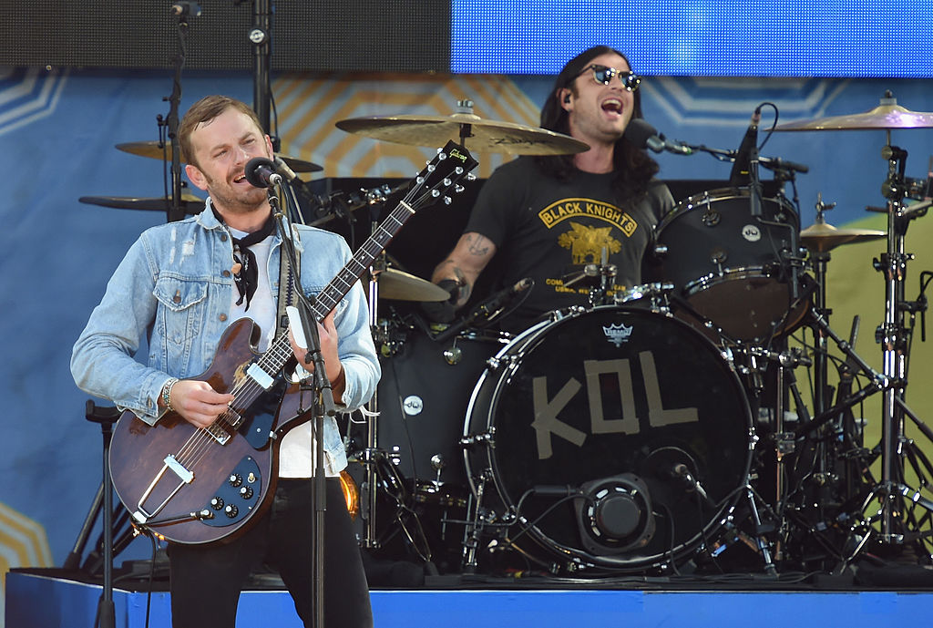 """NEW YORK, NY - JULY 25: Caleb Followill (L) and Nathan Followill of the band Kings of Leon perform On ABC's """"Good Morning America"""" at Rumsey Playfield, Central Park on July 25, 2014 in New York City. (Photo by Mike Coppola/Getty Images)"""