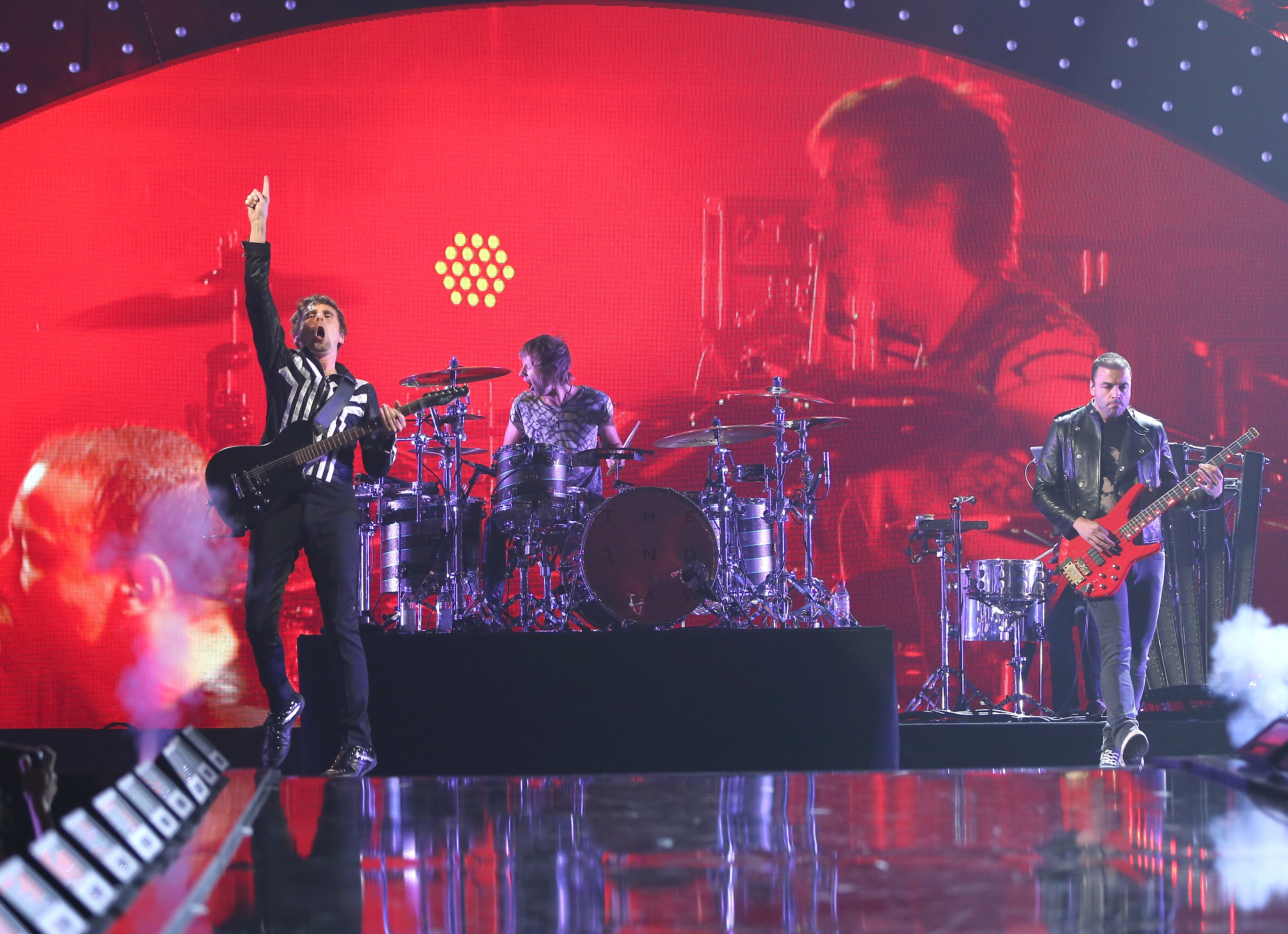 LAS VEGAS, NV - SEPTEMBER 20: Musician Matthew Bellamy of the band Muse performs onstage during the iHeartRadio Music Festival at the MGM Grand Garden Arena on September 20, 2013 in Las Vegas, Nevada. (Photo by Christopher Polk/Getty Images for Clear Channel)