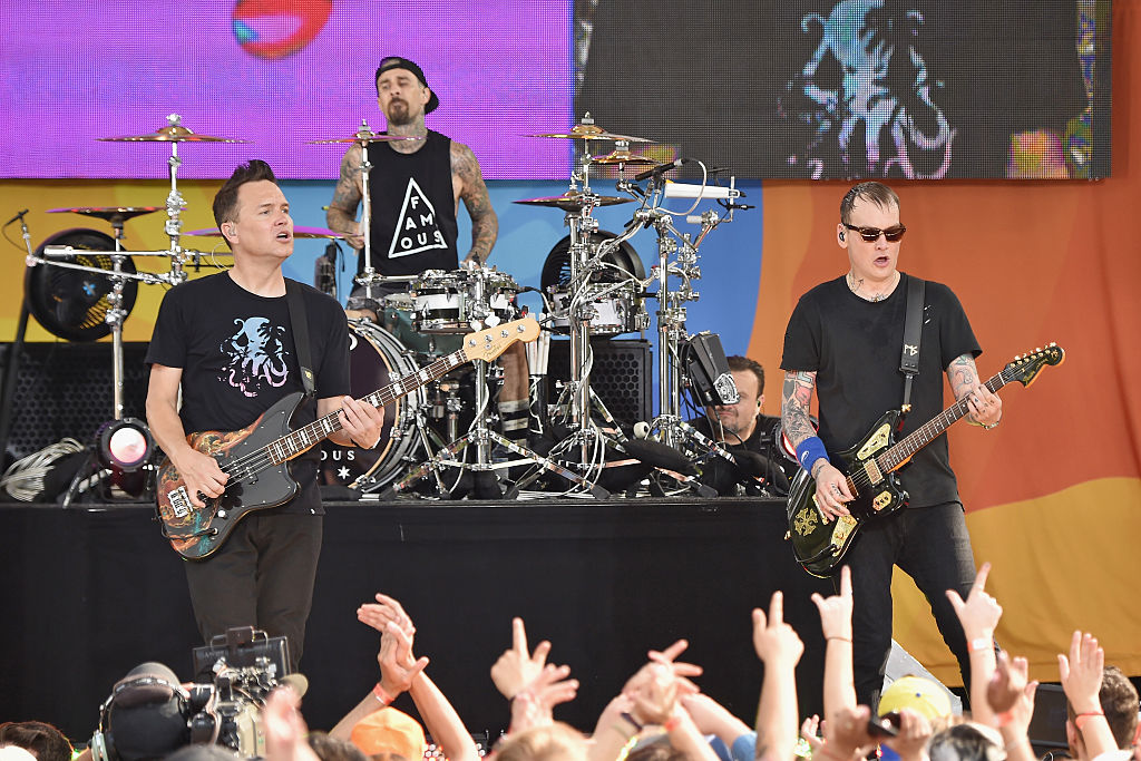 """NEW YORK, NY - JULY 01: (L-R) Mark Hoppus, Travis Barker, and Matt Skiba of the band Blink 182 perform on ABC's """"Good Morning America"""" at SummerStage at Rumsey Playfield, Central Park on July 1, 2016 in New York City. (Photo by Mike Coppola/Getty Images)"""