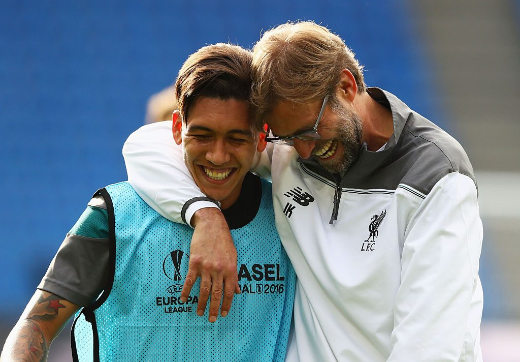 BASEL, SWITZERLAND - MAY 17: Roberto Firmino of Liverpool laughs with manager Jurgen Klopp during a Liverpool training session on the eve of the UEFA Europa League Final against Sevilla at St. Jakob-Park on May 17, 2016 in Basel, Switzerland. (Photo by Michael Steele/Getty Images)