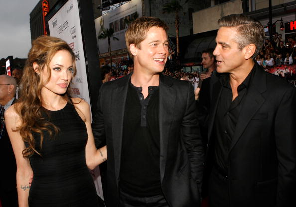 """HOLLYWOOD - JUNE 05: (L-R) Actress Angelina Jolie, actors Brad Pitt and George Clooney arrive to the Warner Bros. premiere of the film """"Ocean's 13"""" at Grauman's Chinese Theatre on June 5, 2007 in Hollywood, California. (Photo by Kevin Winter/Getty Images)"""