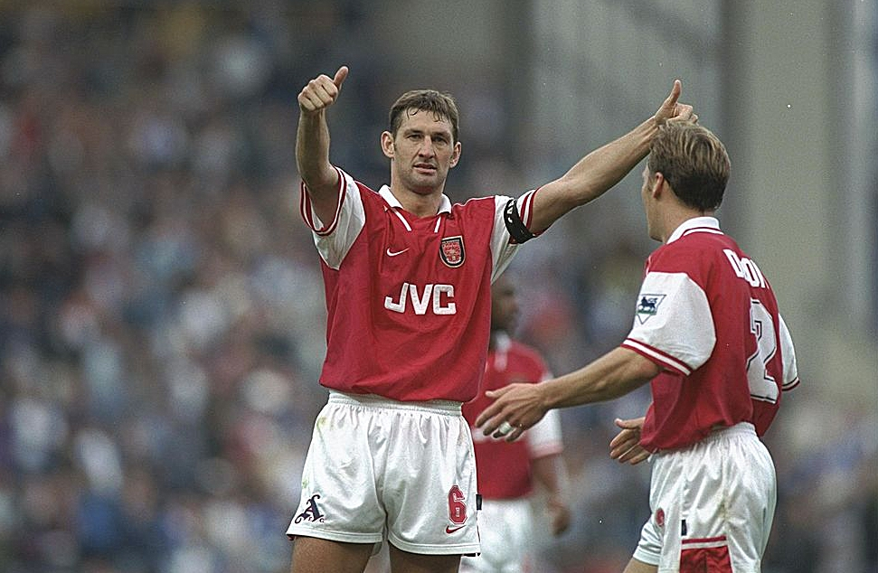 12 Oct 1996: Tony Adams of Arsenal salutes the crowd after his team's victory during the FA Carling Premier league match between Blackburn Rovers and Arsenal at Ewood Park in Blackburn. Arsenal went onto win the match by 0-2. Mandatory Credit: Shaun Botterill/Allsport