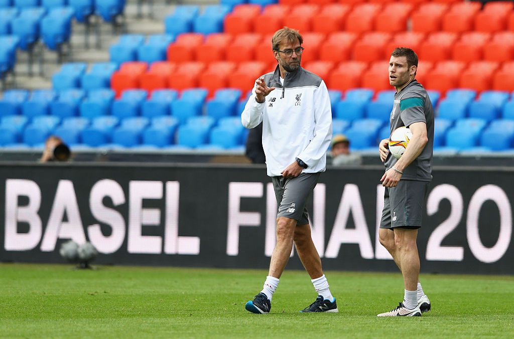 BASEL, SWITZERLAND - MAY 17: Jurgen Klopp, manager of Liverpool talks to James Milner during a Liverpool training session on the eve of the UEFA Europa League Final against Sevilla at St. Jakob-Park on May 17, 2016 in Basel, Switzerland. (Photo by Michael Steele/Getty Images)