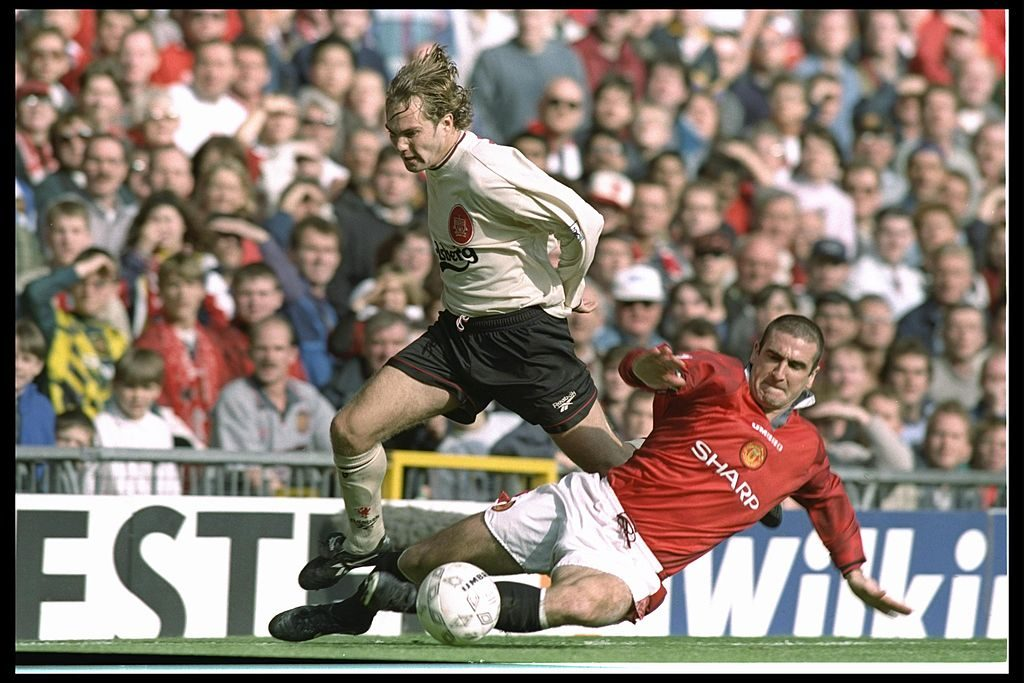 12 Oct 1996: Jason McAteer of Liverpool (left) is brought down by Eric Cantona of Manchester United during the FA Carling Premier league match between Manchester United and Liverpool at Old Trafford in Manchester. Manchester United went onto win the match by 1-0. Mandatory Credit: Clive Brunskill/Allsport
