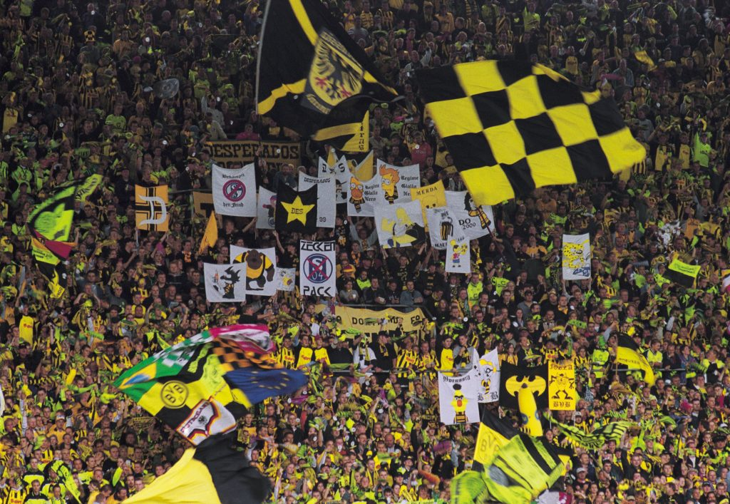 8 Sep 2001: Borussia Dortmund fans cheer their team on during the German Bundesliga match between Borussia Dortmund and Bayern Munich played at the Westfalenstadion, Dortmund, Germany. Mandatory Credit: Stuart Franklin /Allsport