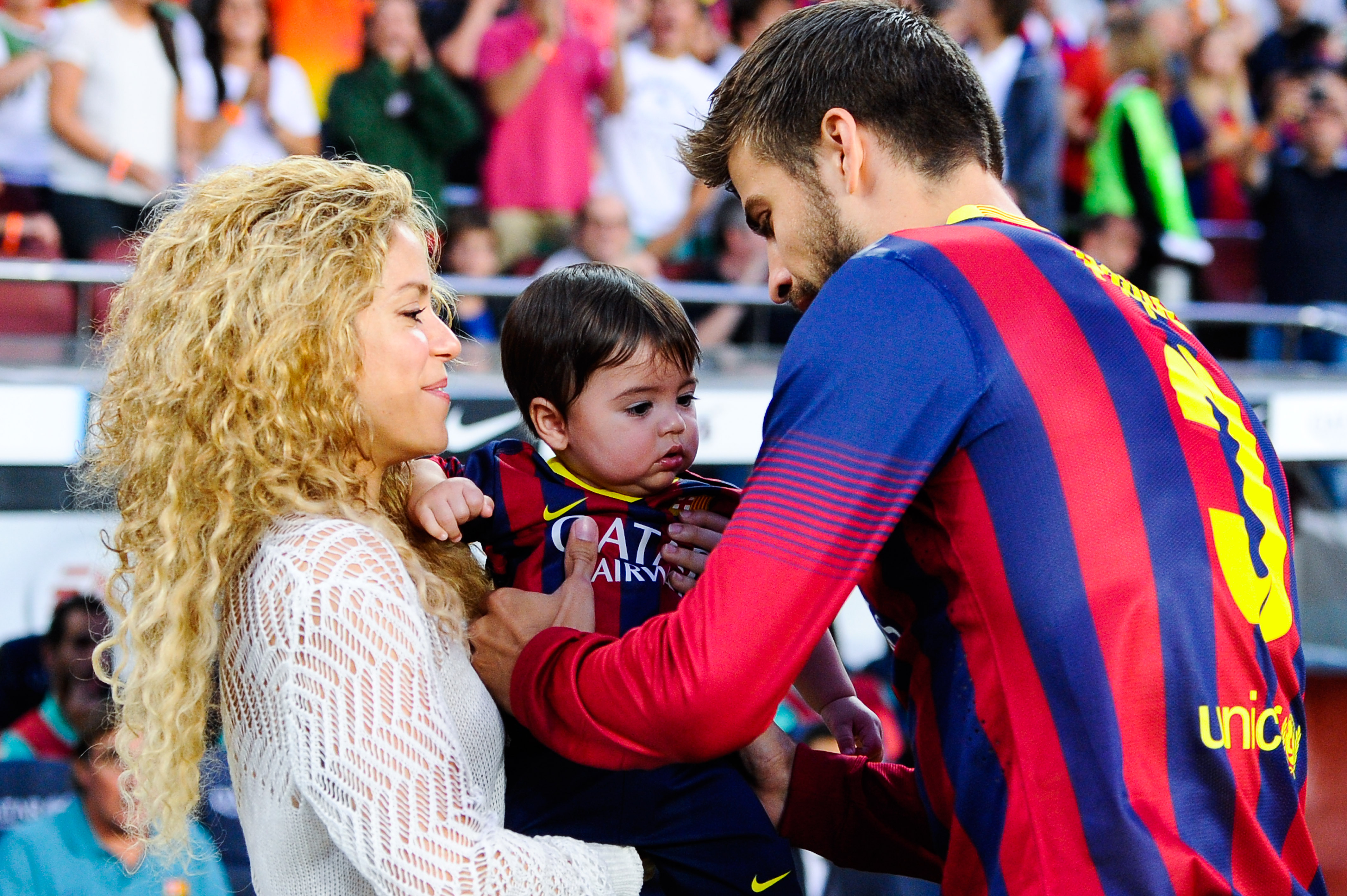 BARCELONA, SPAIN - SEPTEMBER 14: Shakira and Gerard Pique of FC Barcelona are seen with their son Milan prior to the La Liga match between FC Barcelona and Sevilla FC at Camp Nou on September 14, 2013 in Barcelona, Spain. (Photo by David Ramos/Getty Images)