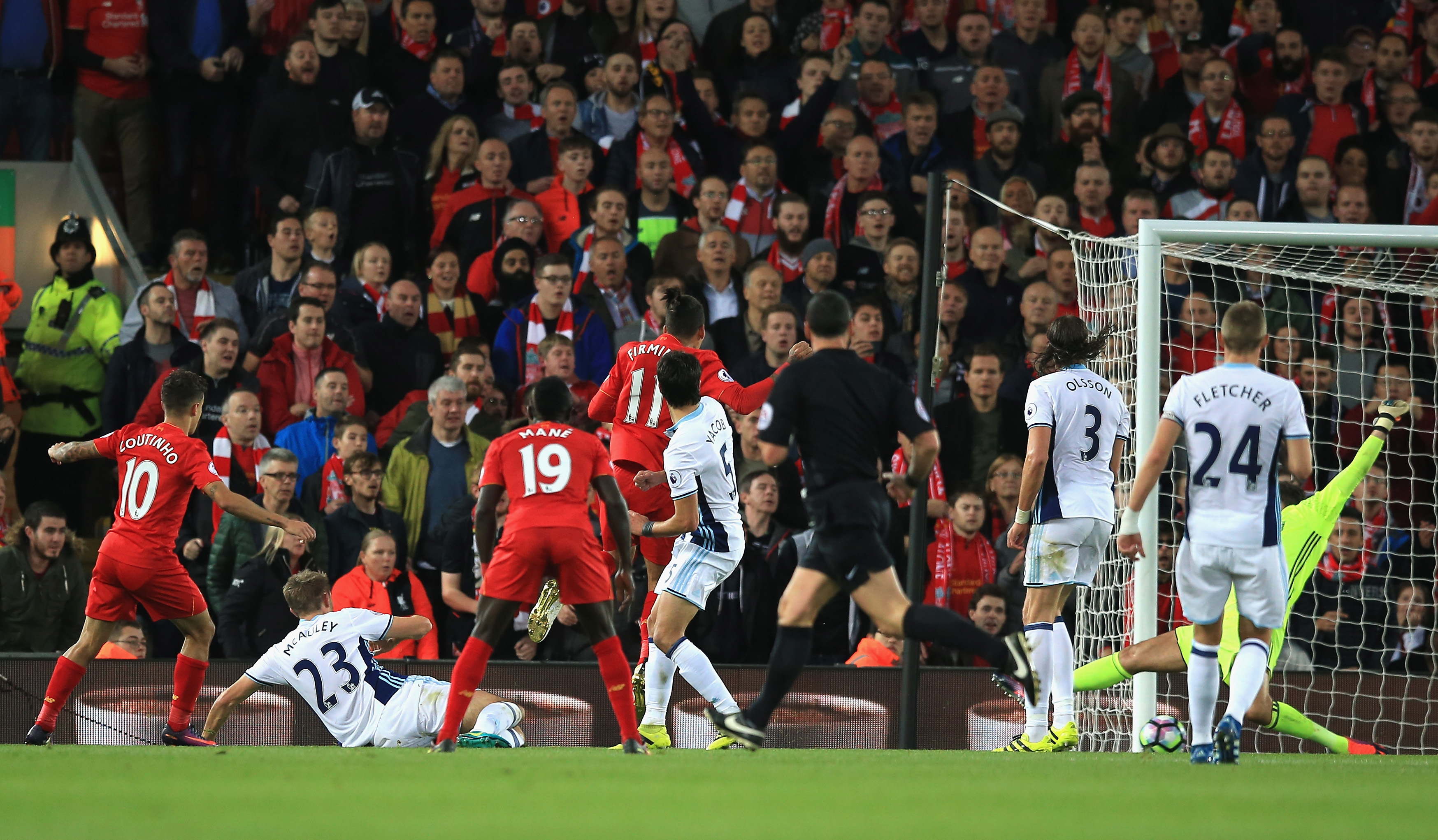 LIVERPOOL, ENGLAND - OCTOBER 22: Philippe Coutinho of Liverpool scores his sides second goal  during the Premier League match between Liverpool and West Bromwich Albion at Anfield on October 22, 2016 in Liverpool, England.  (Photo by Jan Kruger/Getty Images)