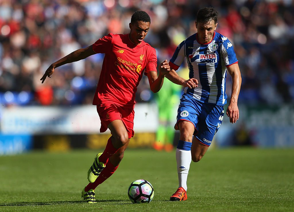 WIGAN, ENGLAND - JULY 17: Jordan Flores of Wigan Athletic and Trent Alexander-Arnold of Liverpool compete for the ball during a pre-season friendly between Wigan Athletic and Liverpool at JJB Stadium on July 17, 2016 in Wigan, England. (Photo by Alex Livesey/Getty Images)