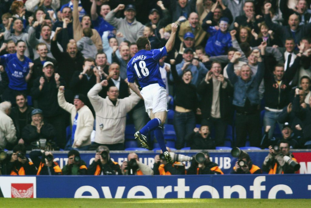 LIVERPOOL - APRIL 6: Wayne Rooney of Everton celebrates scoring the first goal during the FA Barclaycard Premiership match between Everton and Newcastle United held on April 6, 2003 at Goodison Park, in Liverpool, England. Everton won the match 2-1. (Photo by Michael Steele/Getty Images)