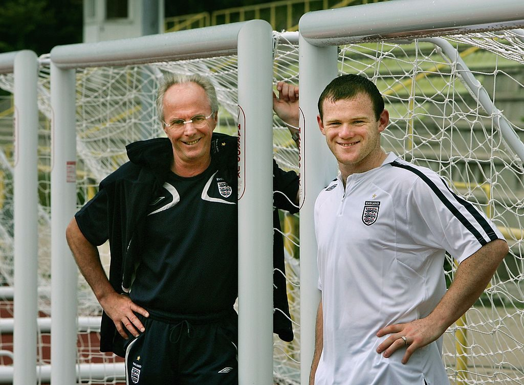 BADEN-BADEN, GERMANY - JUNE 28: Sven Goran Eriksson, the England Head Coach, poses with Wayne Rooney of England after the team's training session at the England World Cup base on June 28, 2006 in Baden-Baden, Germany. (Photo by Adrian Dennis-Pool/Getty Images)