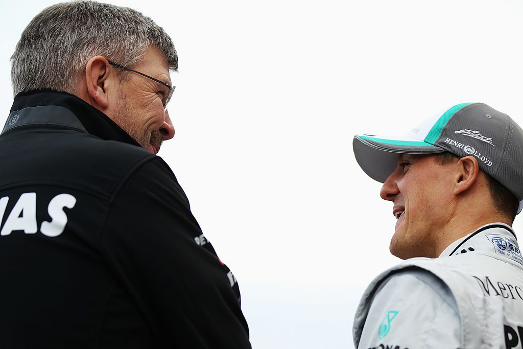VALENCIA, SPAIN - FEBRUARY 01: Michael Schumacher (R) of Germany and Mercedes GP talks with Mercedes GP Team Principal Ross Brawn (L) as they attend the launch of the new Mercedes MGP W02 at the Ricardo Tormo Circuit on February 1, 2011 in Valencia, Spain. (Photo by Mark Thompson/Getty Images)