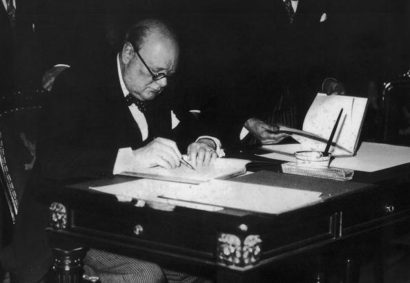 British statesman Winston Churchill (1874 - 1965) puts pen to paper, 1936. (Photo by Keystone/Hulton Archive/Getty Images)