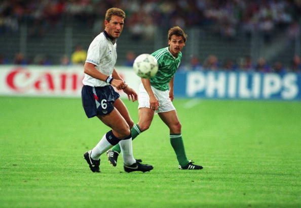 Terry Butcher of England and Olaf Thon of West Germany