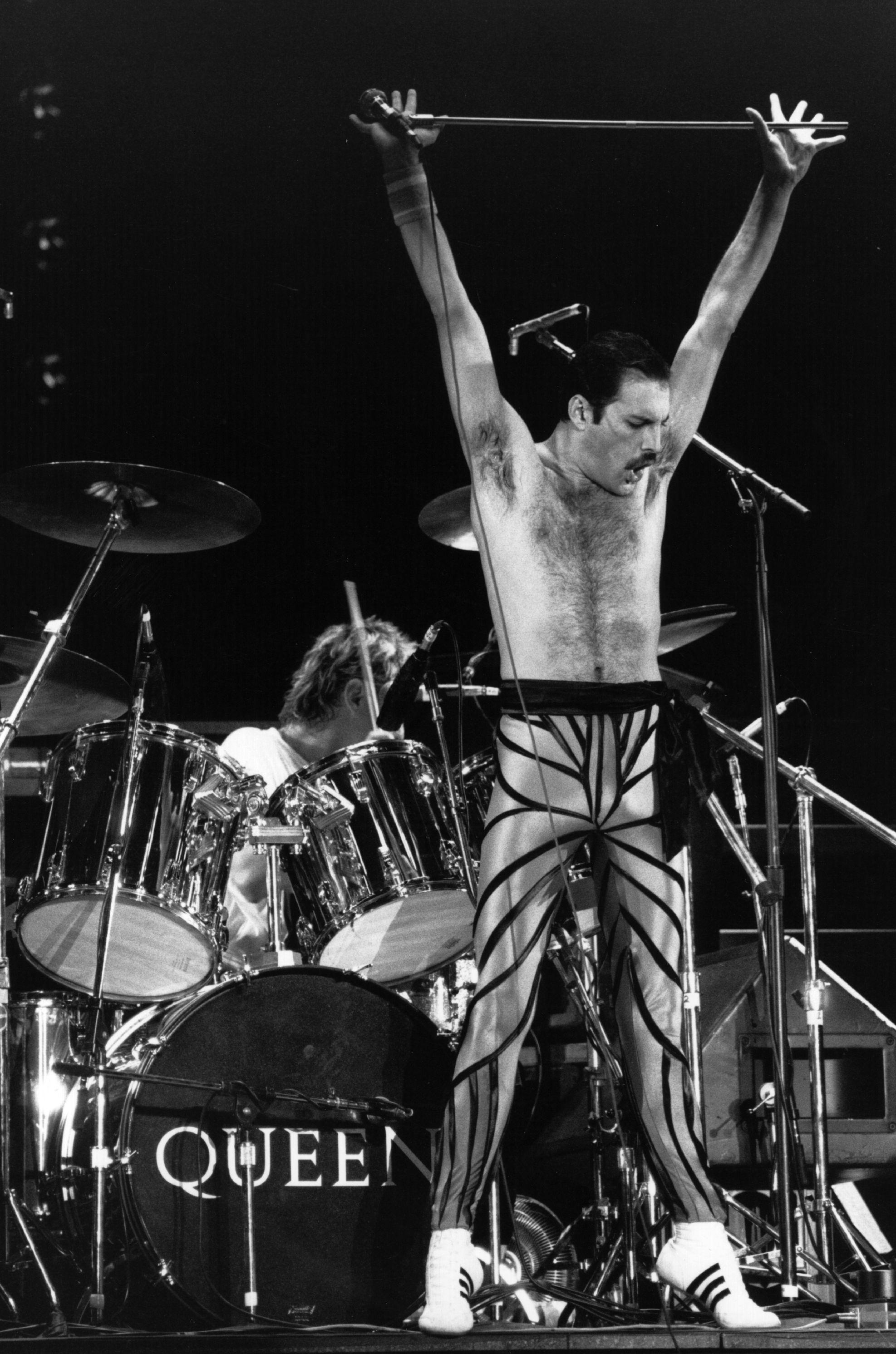 British stadium rock group Queen on stage, with lead singer Freddie Mercury (Frederick Bulsara, 1946 - 1991) in the foreground. Original Publication: People Disc - HU0462 (Photo by Express Newspapers/Getty Images)