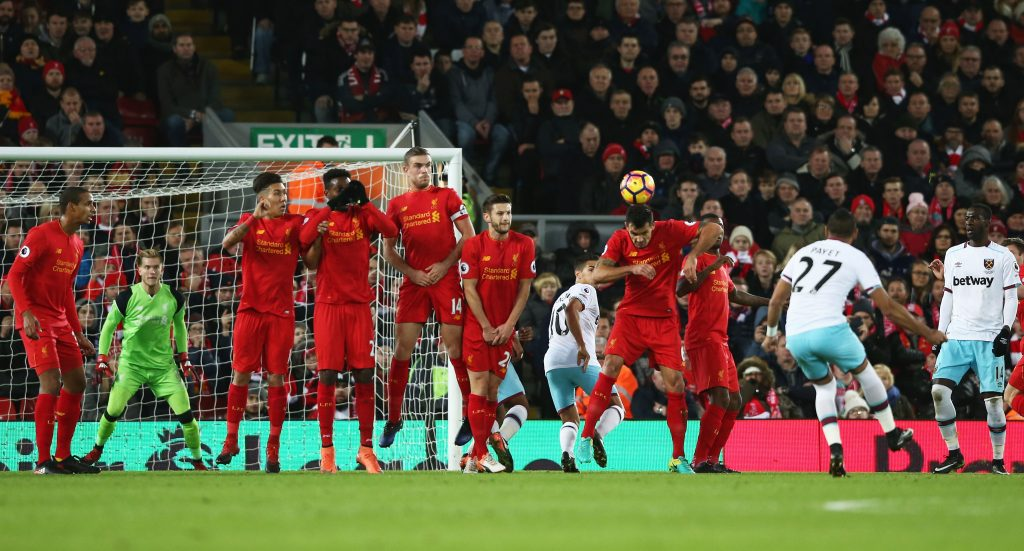 LIVERPOOL, ENGLAND - DECEMBER 11: Dimitri Payet of West Ham United (27) scores their first goal from a free kick during the Premier League match between Liverpool and West Ham United at Anfield on December 11, 2016 in Liverpool, England. (Photo by Jan Kruger/Getty Images)
