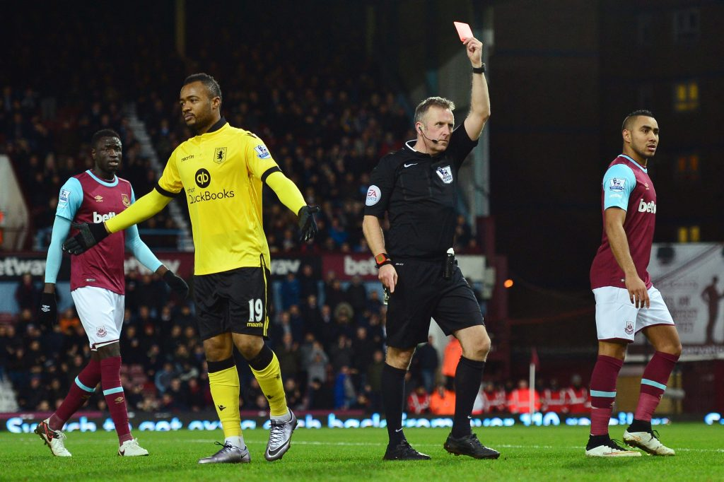 LONDON, ENGLAND - FEBRUARY 02: Jordan Ayew of Aston Villa is shown a red card by referee Jonathan Moss during the Barclays Premier League match between West Ham United and Aston Villa at the Boleyn Ground on February 2, 2016 in London, England. (Photo by Dan Mullan/Getty Images)