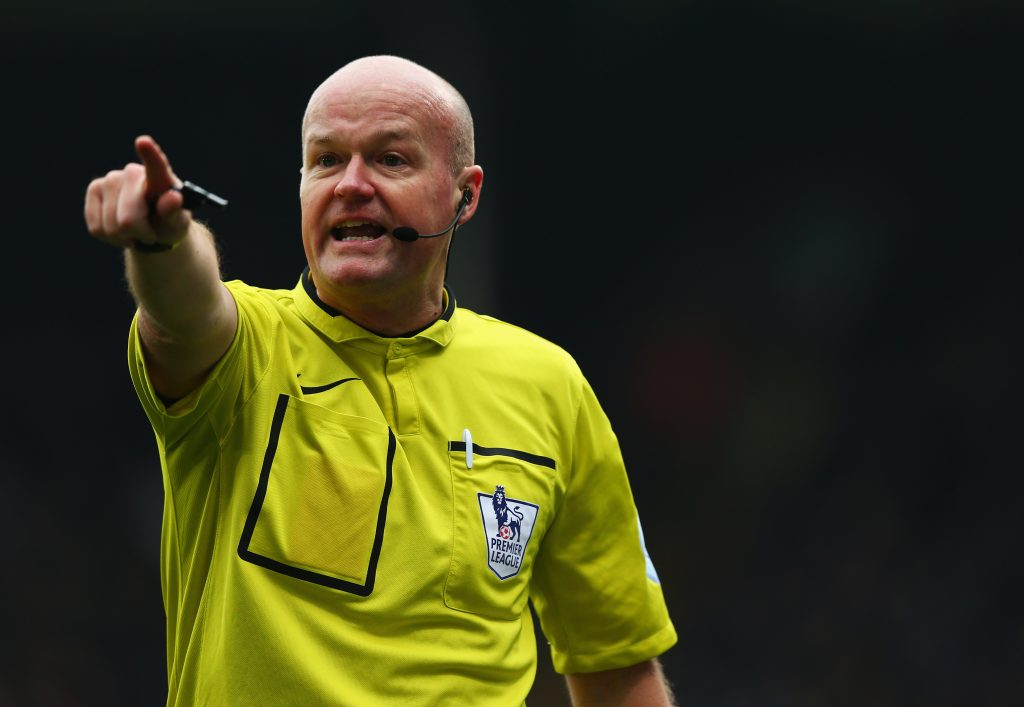 LONDON, ENGLAND - MARCH 14: Referee Lee Mason makes his point during the Barclays Premier League match between Crystal Palace and Queens Park Rangers at Selhurst Park on March 14, 2015 in London, England. (Photo by Matthew Lewis/Getty Images)