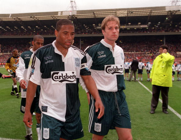 1cc8dcd9d Liverpool players pictured in unusual new away kit
