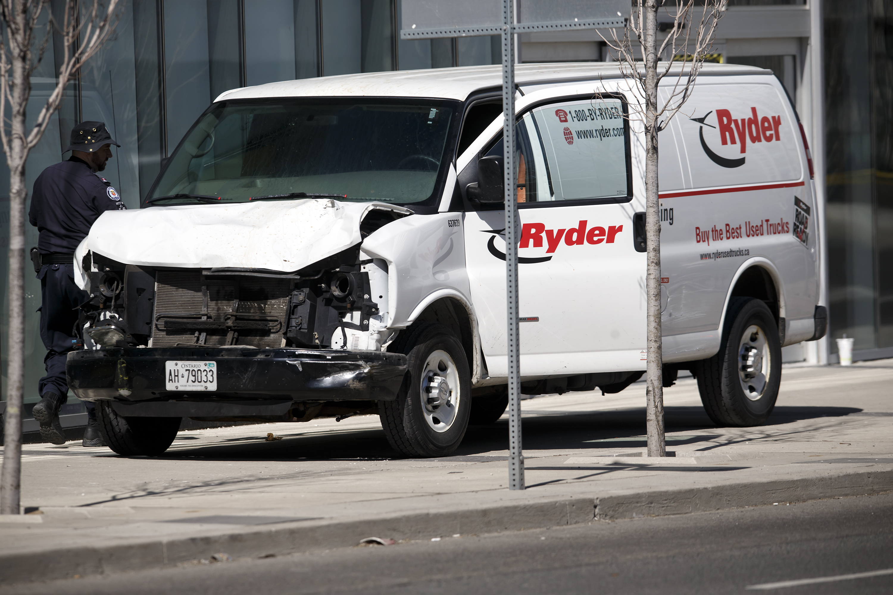 Police inspect a van involved in a collision killing 10 people at Yonge Street and Finch Avenue in Toronto, Canada, that may have been carried out by an incel
