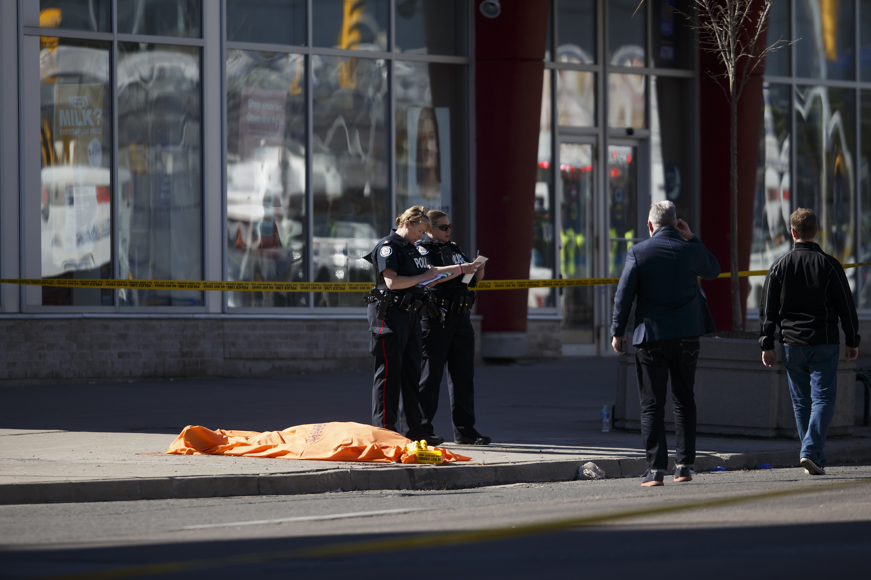 An unidentified body at the scene after a van plowed into pedestrians on April 23, 2018