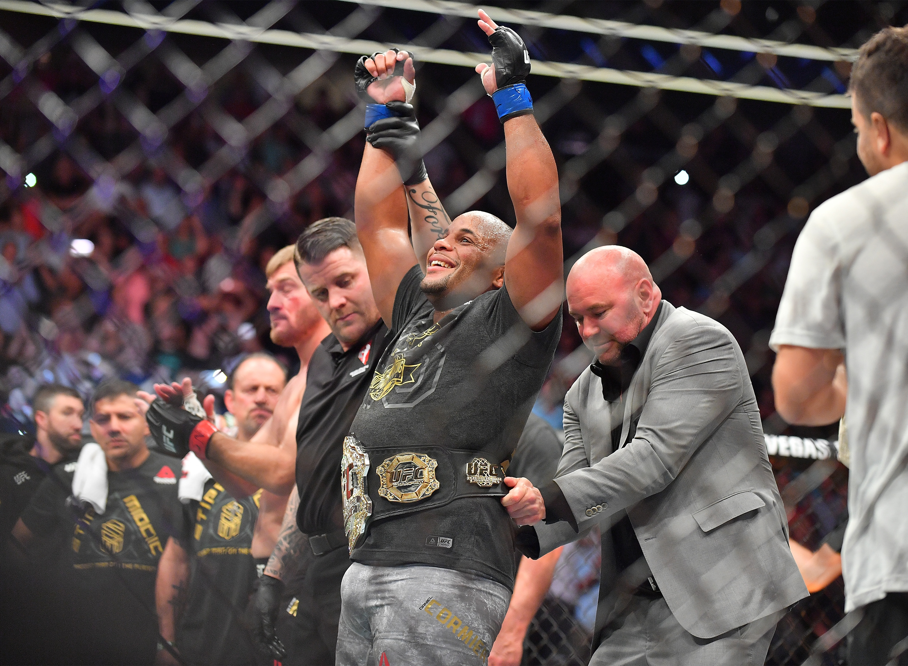 LAS VEGAS, NV - JULY 07: UFC President Dana White (R) places the championship belt around the waist of Daniel Cormier after he defeated Stipe Miocic in their heavyweight championship fight at T-Mobile Arena on July 7, 2018 in Las Vegas, Nevada. Cormier won by first round knockout. (Photo by