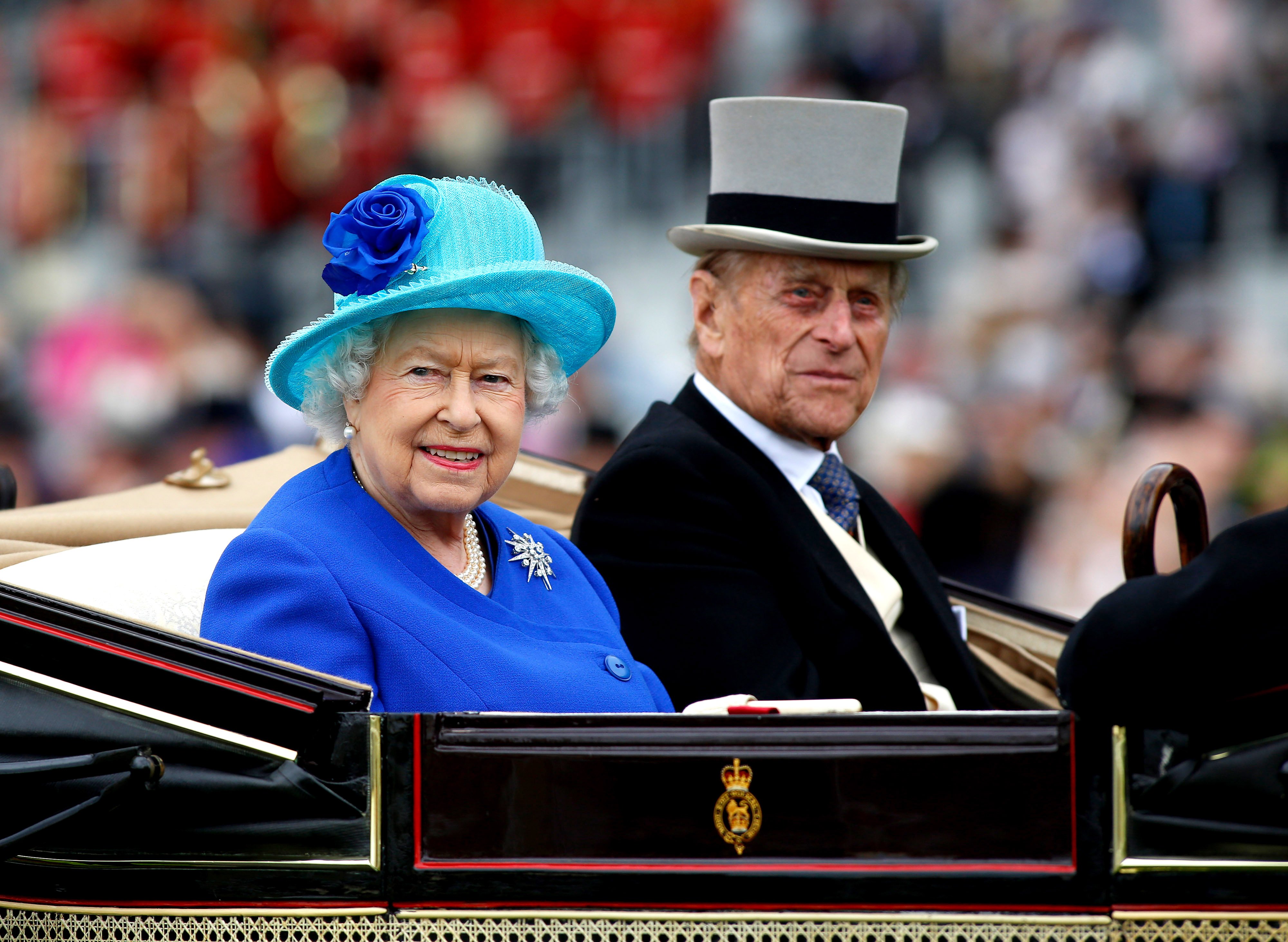 ASCOT, ENGLAND - JUNE 18: Queen Elizabeth II and Prince Philip, Duke of Edinburgh take part in the carriage procession during Day Five of Royal Ascot at Ascot Racecourse on June 18, 2016 in Ascot, England. (Photo by Julian Herbert/Getty Images)